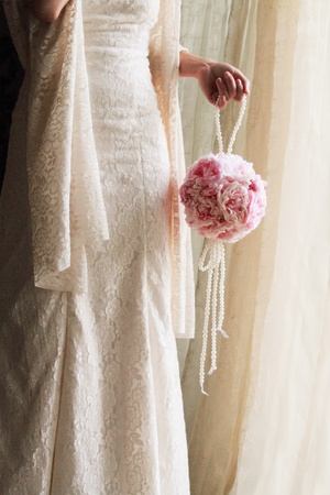beauty Bride with a wedding bouquet photo