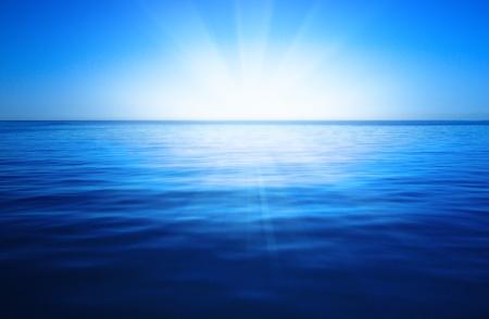 太陽、青い空と海 写真素材