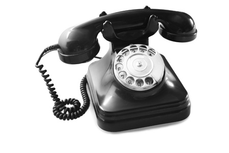 an old black telephon with rotary dial photo