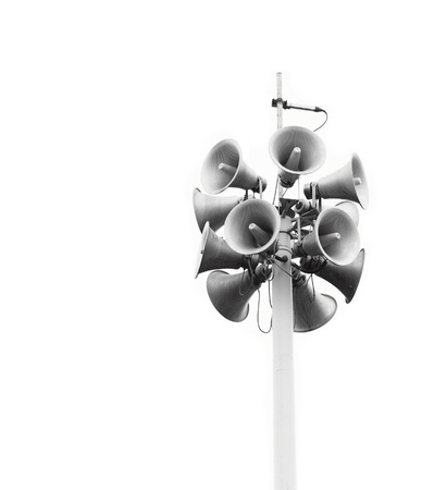 Lots of loudspeakers on a tall column photo