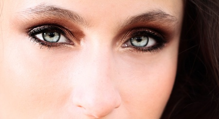 Close up of a woman blue eyes  photo