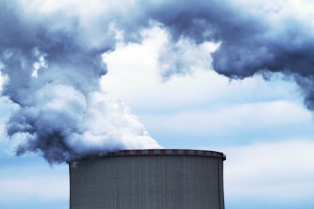 industrial smoke from chimney on blue sky photo