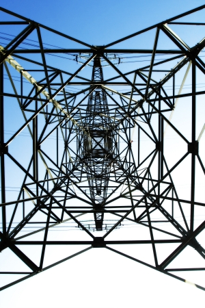 Detail of electricity pylon against blue sky Stock Photo - 14235354