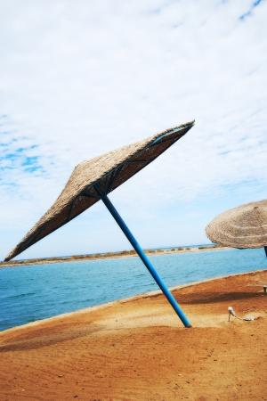Wicker Beach Umbrella with wicker wind breaks