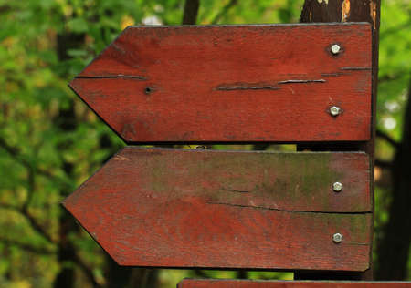 Two wooden arrow road signs photo