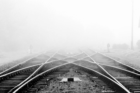 work station: Railway in fog on station, outdoor landscape