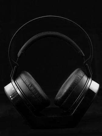 Black modern Headphones on a black background Stock Photo - 16912120