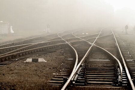 Railway in fog on station, outdoor landscape