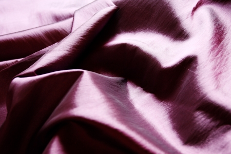 pleat: Purple textile texture with dark creases and selective focus Stock Photo