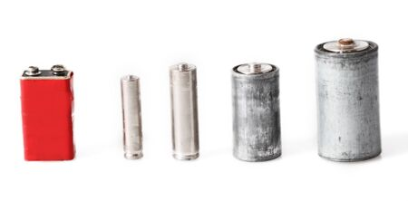 Old batteries isolated on white background photo