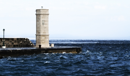tempest: Picture represents the lighthouse while blowing strong wind  Croatia-Senj Stock Photo