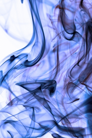 Blue smoke in white background photo
