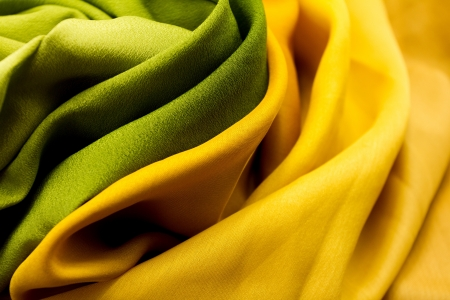 Golden and green satin textile background  close up  photo