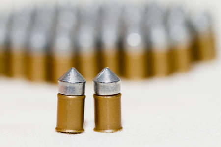 Gun bullets over white background photo