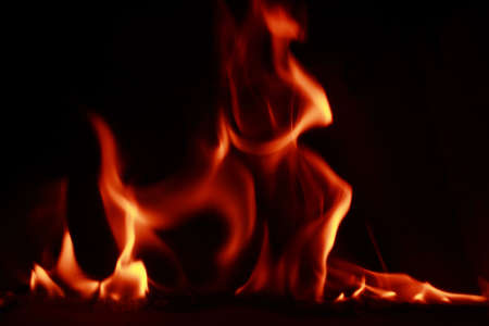 Fire flames with reflection on dark background photo
