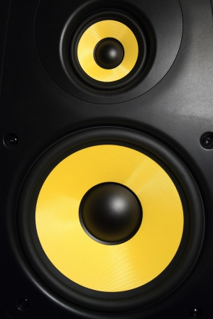 Closeup of a yellow speaker sub woofer