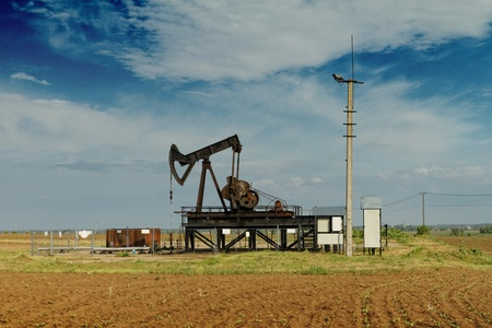 Operating oil and gas well on the meadow photo