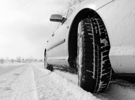 Close up of a cars tires on a snowy road Stock Photo - 21353389
