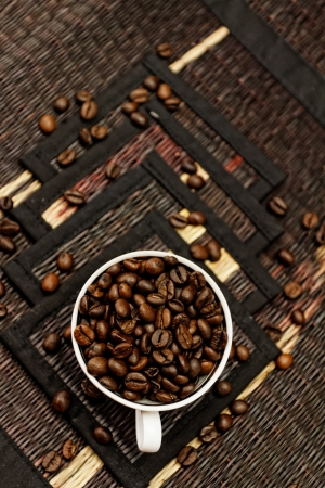 Coffee beans in ceramic white coffee cup photo
