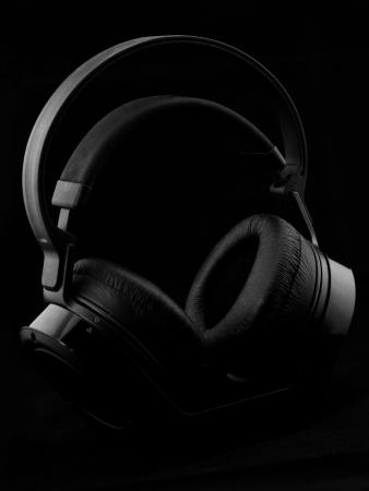 Black modern Headphones on a black background photo