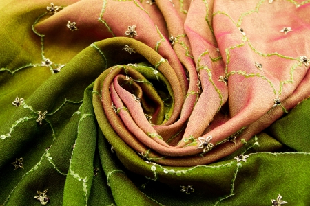 Pink and green satin textile background (close up) photo