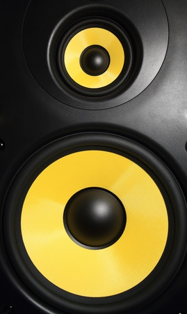 sub woofer: Closeup of a yellow speaker sub woofer
