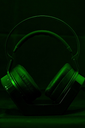 Black modern Headphones on a green background Stock Photo - 21361093
