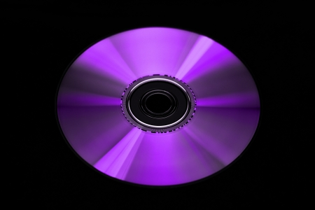 Digital Versatile Disk isolated on black background photo