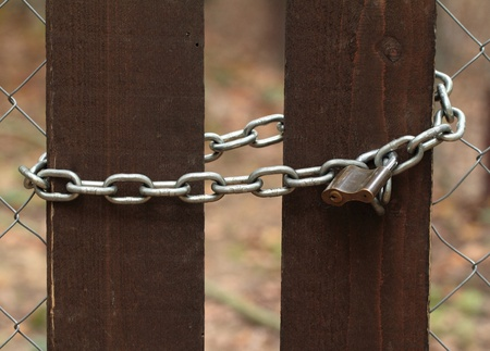 Old lock on the wood door of color brown photo