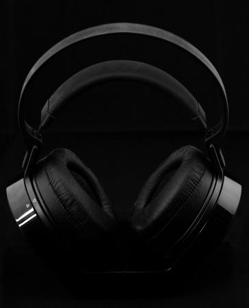 Black modern Headphones on a black background Stock Photo - 21662387