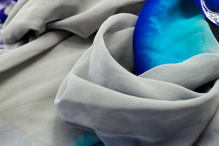 Blue and silver satin textile background (close up) photo