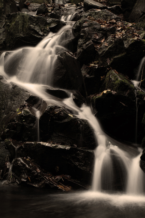 range of motion: Waterfall in the autumn Stock Photo