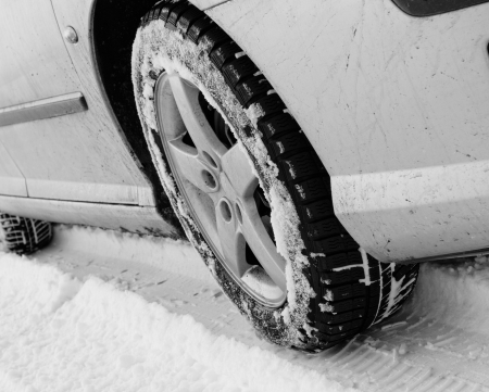 Close up of a cars tires on a snowy road Stock Photo - 22666027
