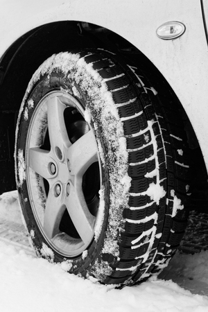 Close up of a cars tires on a snowy road Stock Photo - 22666030