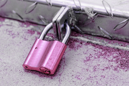 A padlock on an iron door - close-up photo