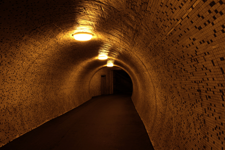 Pedestrian tunnel in the night photo