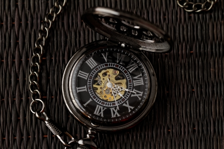 Old watch machine on dark background photo