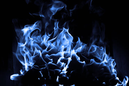 Blue flame isolated on dark  Stock Photo - 23785812