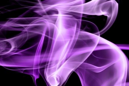 Purple smoke in black background photo
