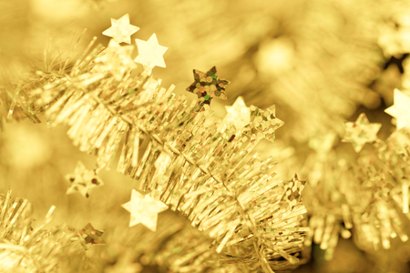 Golden tinsel Christmas decoration - close-up photo photo