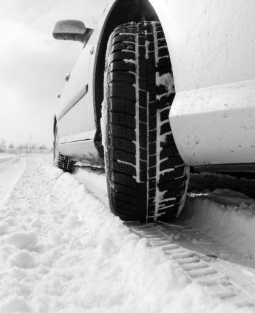 Close up of a cars tires on a snowy road photo