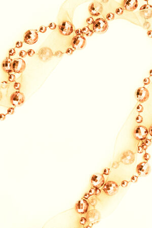 Close up of golden garland  Light background  photo