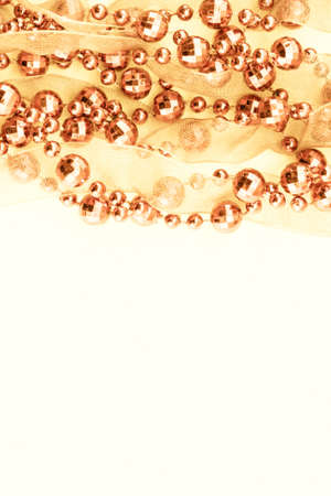 Close up of golden garland. Light background. photo