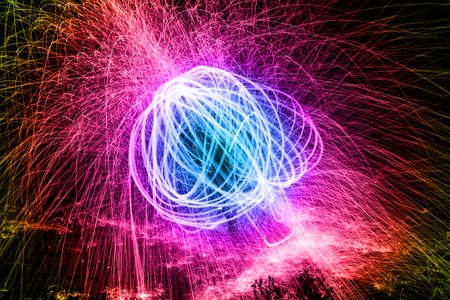 Showers of hot glowing sparks from spinning steel wool. Stock Photo - 24488619