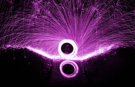 Showers of hot glowing sparks from spinning steel wool. Stock Photo - 24804663