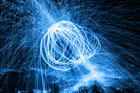 Showers of hot glowing sparks from spinning steel wool. Stock Photo - 25111475