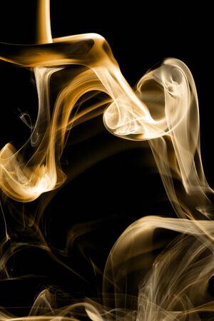 yelllow: Brown smoke on natural black background