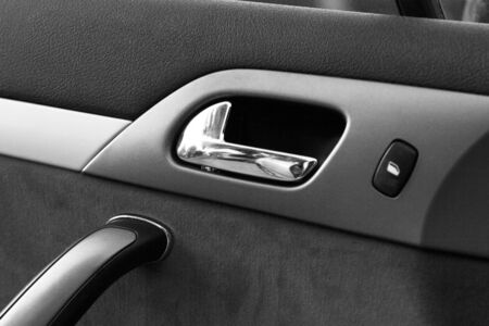 raiser: Car door handle with power window control unit