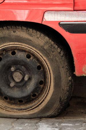 A closeup shot of a flat tire of a car photo