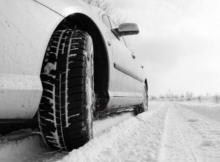 Close up of a cars tires on a snowy road Stock Photo - 25292423